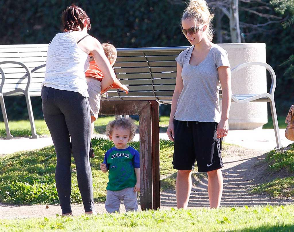 """Across L.A. in Encino, California, reality star Kendra Wilkinson and her son Hank hung for a play date at the park with friends the same afternoon. <a href=""""http://www.infdaily.com"""" target=""""new"""">INFDaily.com</a> - January 23, 2011"""