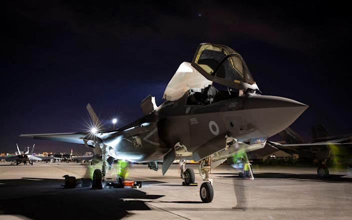 An F-35 Lightning aircraft from 617 Squadron from RAF Marham, undergoing general post flight checks at Nellis Air Force Base in Nevada. British and American F-35 jets will be an integral part of the initial Carrier Strike Group deployment. - Cpl Amy Lupton RAF