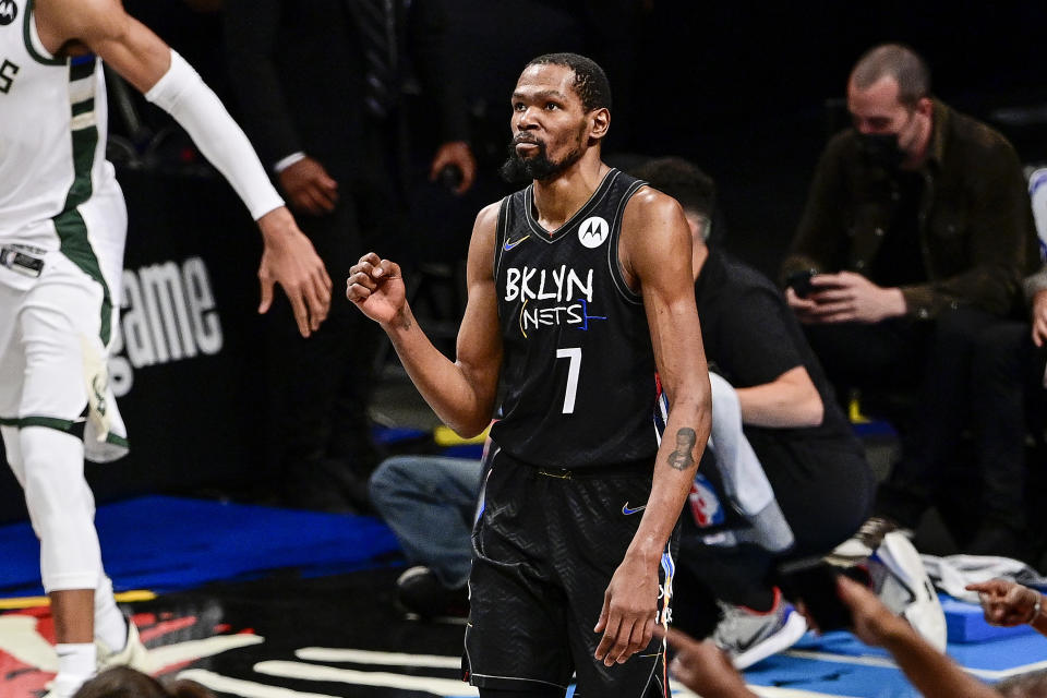 Kevin Durant #7 of the Brooklyn Nets celebrates against the Milwaukee Bucks in Game Five of the Second Round of the 2021 NBA Playoffs at Barclays Center on June 15, 2021 in New York City. NOTE TO USER: User expressly acknowledges and agrees that, by downloading and or using this photograph, User is consenting to the terms and conditions of the Getty Images License Agreement. (Photo by Steven Ryan/Getty Images)