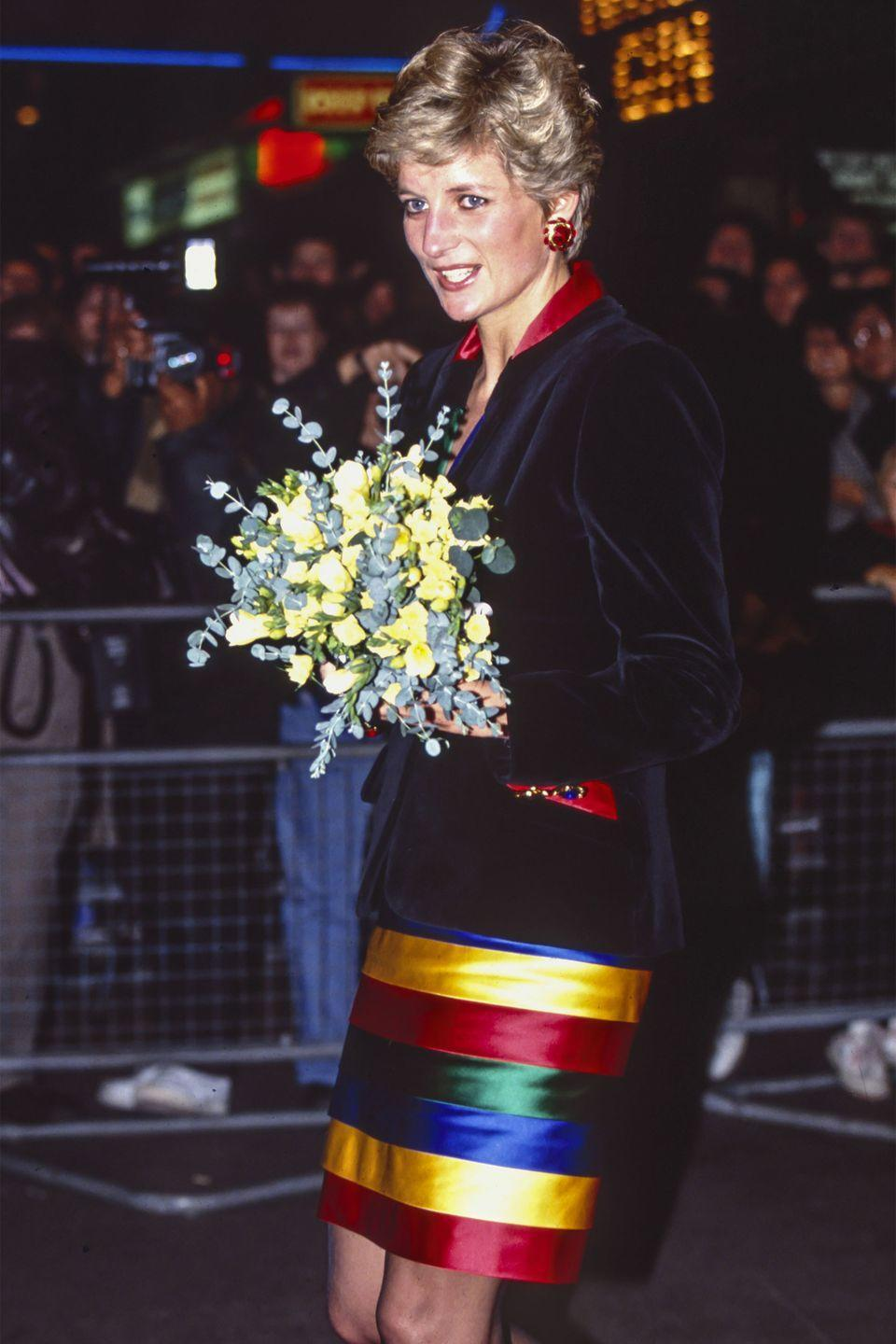 <p>In a metallic striped strapless dress and velvet blazer attending a rock concert in London. </p>