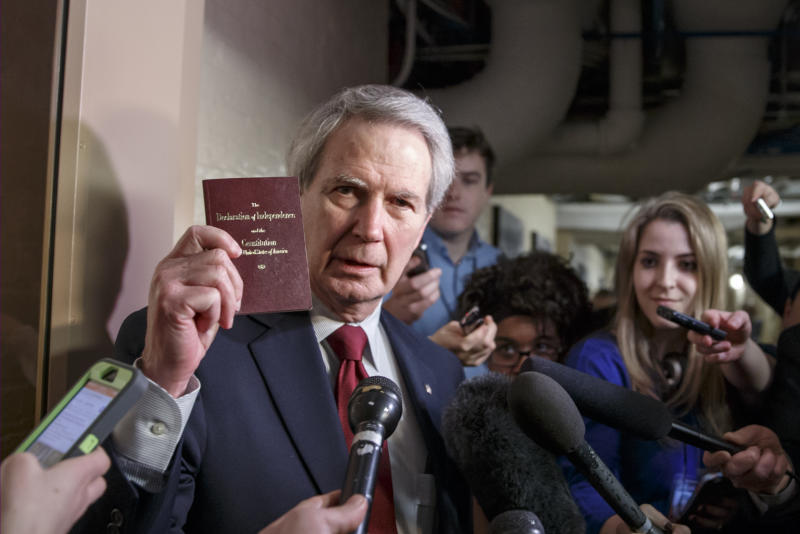 FILE - In this Thursday, Feb. 26, 2015, file photo, U.S. Rep. Walter B. Jones Jr., R-N.C., holds up a copy of the Constitution while talking to reporters as House Republicans emerge from a closed-door meeting on how to deal with the impasse over the Homeland Security budget, at the Capitol in Washington. Jones, a once-fervent supporter of the 2003 invasion of Iraq who later became an equally outspoken Republican critic of the war, died Sunday, Feb. 10, 2019, his 76th birthday. (AP Photo/J. Scott Applewhite, File)