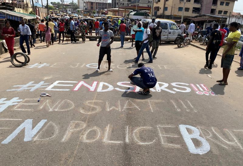 A demonstrator paints 'End Sars' during a protest demanding police reform in Lagos