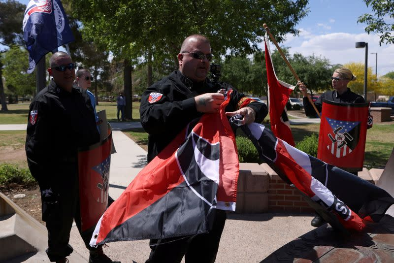 FILE PHOTO: Burt Colucci of the white nationalist group National Socialist Movement destroys a flag of the anti-facist movement