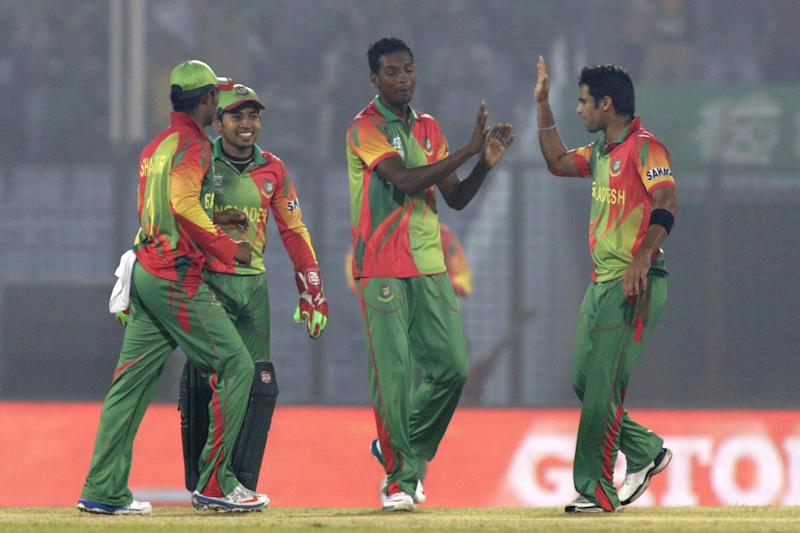 Bangladesh's Al-Amin Hossain, center, celebrates with teammates the fall of Nepalese wicket during their ICC Twenty20 Cricket World Cup match in Chittagong, Bangladesh, Tuesday, March 18, 2014. (AP Photo/Bikas Das)