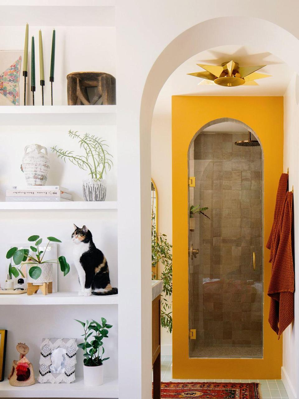 "<p>Liven up your shower with an archway. This warm yellow one by <a href=""http://www.oldbrandnew.com/blog/2020/3/before-after-my-new-master-bedroom-and-bathroom"" rel=""nofollow noopener"" target=""_blank"" data-ylk=""slk:Old Brand New"" class=""link rapid-noclick-resp"">Old Brand New</a> gives the bathroom a vibrance that a plain rectangle-shaped shower would lack.</p>"