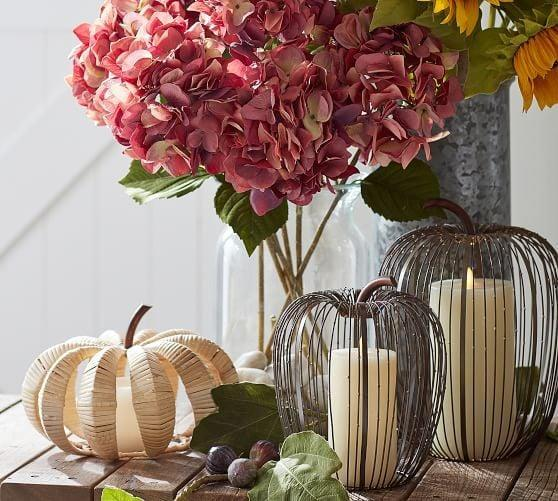 <p>No matter your interior's style, the <span>Beaded Wire Pumpkin Hurricane </span> ($50-$59) blends in wherever it's placed.</p>