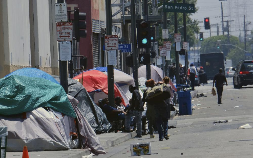 """<span class=""""element-image__caption"""">Homeless camps line a street in downtown Los Angeles.</span> <span class=""""element-image__credit"""">Photograph: Richard Vogel/Associated Press</span>"""