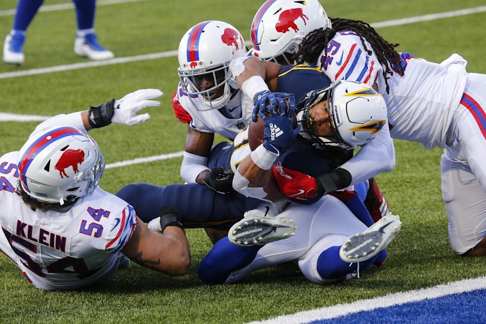 Chargers running back Austin Ekeler (30) is tackled by Buffalo Bills defense short of the goal line.