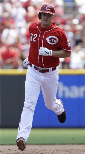 Cincinnati Reds' Jay Bruce rounds the bases after hitting a solo home run off Pittsburgh Pirates starting pitcher Brandon Cumpton in the fourth inning of a baseball game, Thursday, June 20, 2013, in Cincinnati. (AP Photo/Al Behrman)