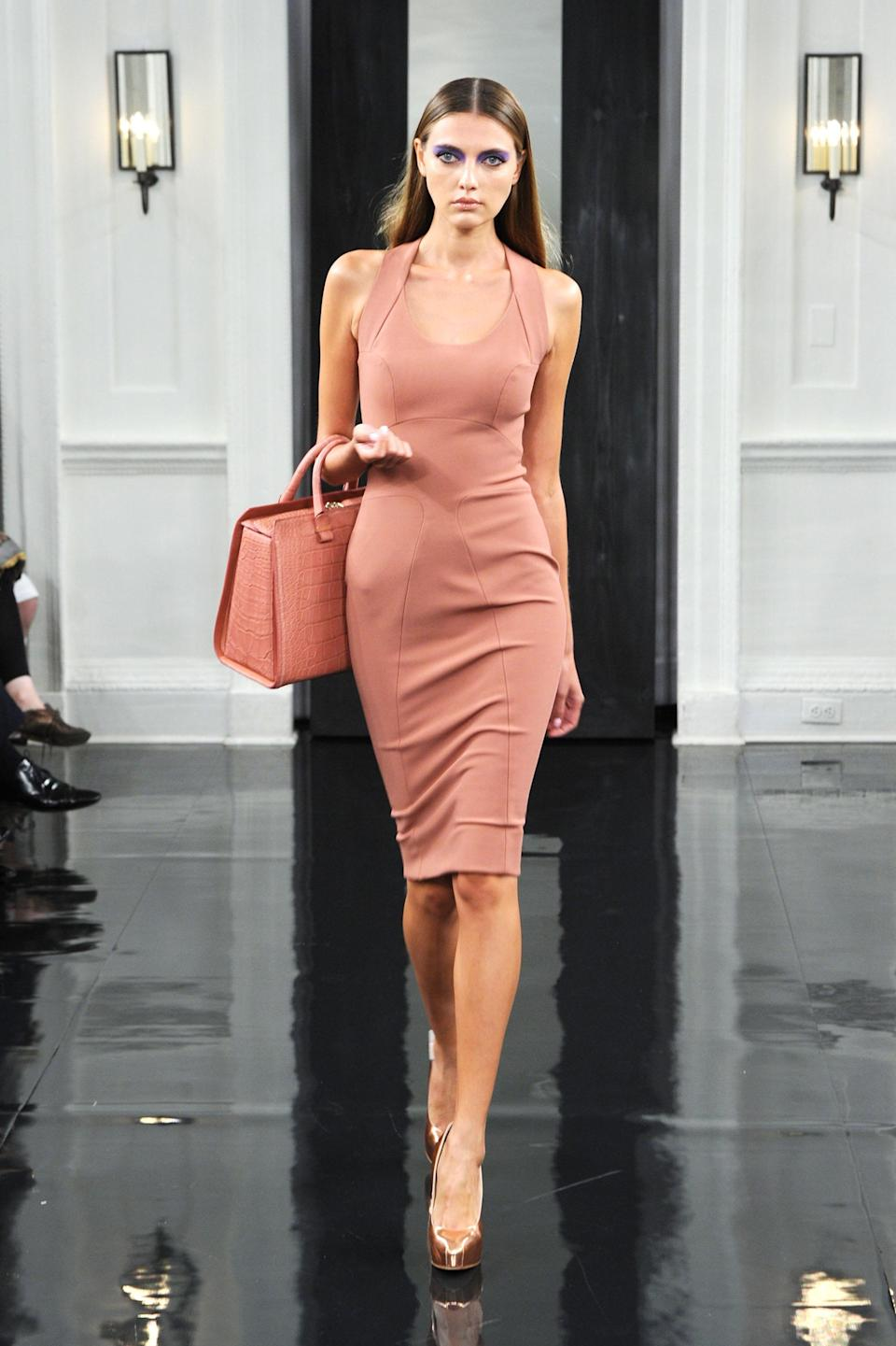 <p>Though bodycon dresses and oxy cradle-on-the-arm handbags still featured heavily in her SS11 show, the colour palete notably softened – a subtle hint at the future of the brand. <em>[Photo: Getty]</em> </p>