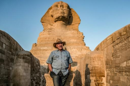 Egyptian archaeologist and former antiquities minister Zahi Hawass stands in front the Great Sphinx of Giza during a lecture with a group of tourists