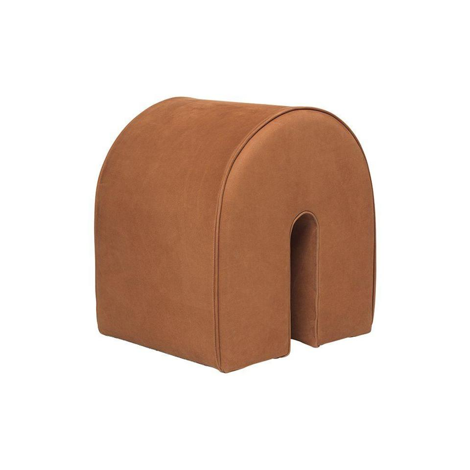 """<p><strong>Kristina Dam</strong></p><p>kristinadam.dk</p><p><strong>689.00</strong></p><p><a href=""""https://kristinadam.dk/collections/seatings/products/ss20-curved-pouf-cognac-leather"""" rel=""""nofollow noopener"""" target=""""_blank"""" data-ylk=""""slk:Shop Now"""" class=""""link rapid-noclick-resp"""">Shop Now</a></p><p>This straightforward pouf design would be an ideal graphic accent in any room—and it can double as a seat or footrest.</p>"""