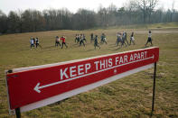 Curly Shirley Catton's exercise class walks through the Nethermead, a meadow, Thursday, Jan. 14, 2021, in Brooklyn's Prospect Park in New York. (AP Photo/Kathy Willens)