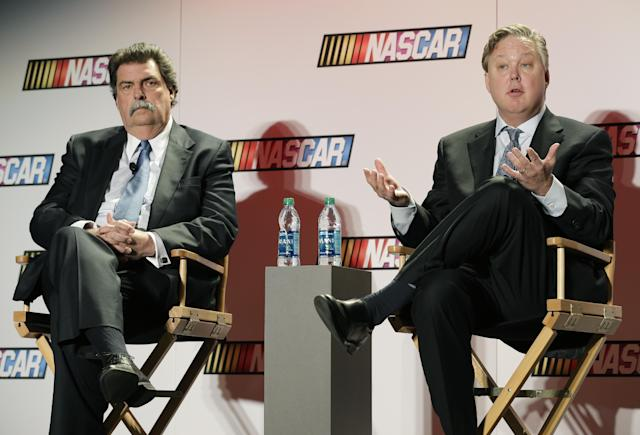 NASCAR CEO Brian France, right, speaks to the media as NASCAR president Mike Helton, left, listens during a news conference at the NASCAR Sprint Cup auto racing Media Tour in Charlotte, N.C., Thursday, Jan. 30, 2014. (AP Photo)
