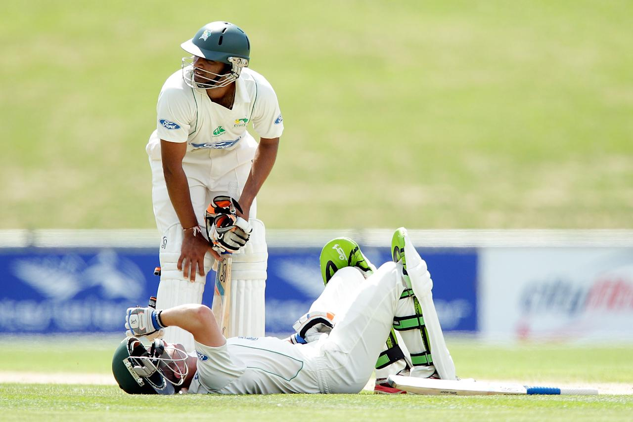 NAPIER, NEW ZEALAND - JANUARY 24:  Jeet Raval of the Stags checks on teammate Carl Cachopa after he was struck by the ball during the Plunket Shield match between the Central Stags and the Cantebury Wizards at McLean Park on January 24, 2013 in Napier, New Zealand.  (Photo by Hagen Hopkins/Getty Images)