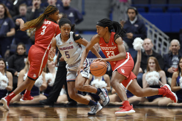 Houston's Julia Blackshell-Fair (23) dribbles as Connecticut's Crystal Dangerfield (5) defends in the second half of an NCAA college basketball game, Saturday, Jan. 11, 2020, in Hartford, Conn. (AP Photo/Jessica Hill)
