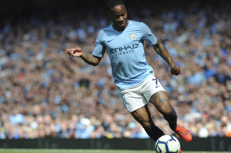 Manchester City's Raheem Sterling runs with the ball during the English Premier League soccer match between Manchester City and Tottenham Hotspur at Etihad stadium in Manchester, England, Saturday, April 20, 2019. (AP Photo/Rui Vieira)