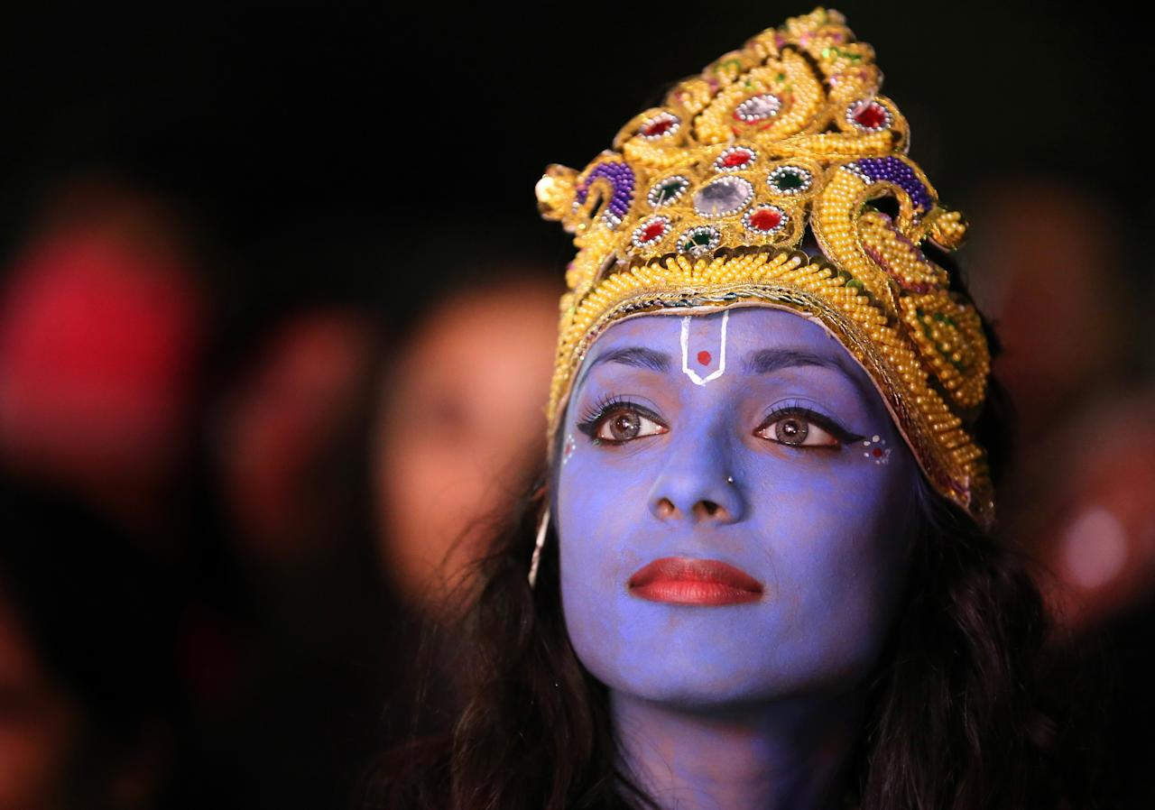 Dancer Vimi Solanki waits to perform on stage as Lord Krishna during the Hindu festival of Diwali on November 13, 2012 in Leicester, United Kingdom. Up to 35,000 people attended the Diwali festival of light in Leicester's Golden Mile in the heart of the city's asian community. The festival is an opportunity for Hindus to honour Lakshmi, the goddess of wealth and other gods. Leicester's celebrations are one of the biggest in the world outside India. Sikhs and Jains also celebrate Diwali.  (Photo by Christopher Furlong/Getty Images)