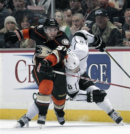 Anaheim Ducks right wing Kyle Palmieri, left, is checked by Los Angeles Kings defenseman Drew Doughty in the second period of an NHL hockey game in Anaheim, Calif., Friday, March 16, 2012. (AP Photo/Jae C. Hong)