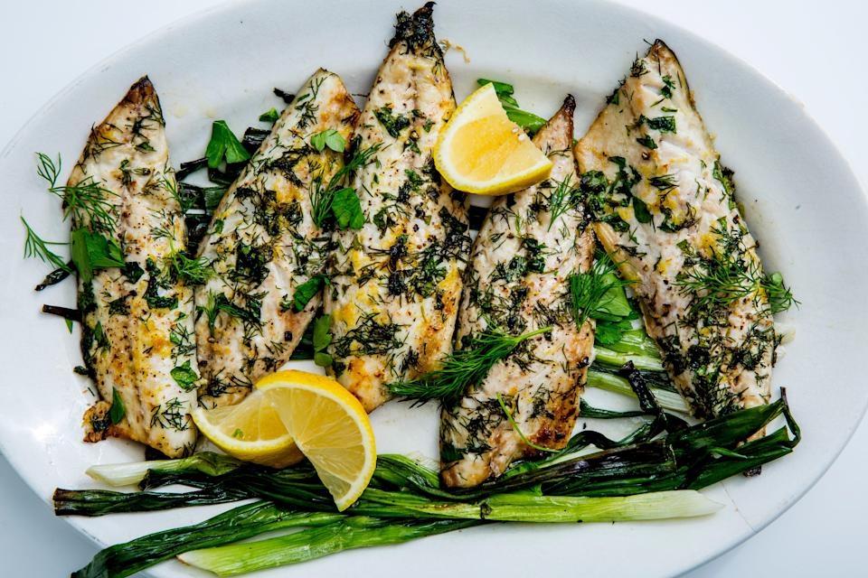 """Mackerel is delightfully hard to overcook. If you can't find it, choose another oily fish: Black cod and wild sockeye salmon will both work, though they require a longer cooking time. <a href=""""https://www.bonappetit.com/recipe/broiled-mackerel-scallions-lemon?mbid=synd_yahoo_rss"""" rel=""""nofollow noopener"""" target=""""_blank"""" data-ylk=""""slk:See recipe."""" class=""""link rapid-noclick-resp"""">See recipe.</a>"""