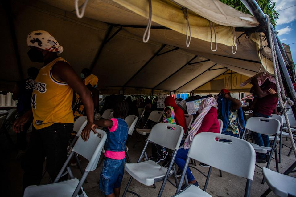 Expelled migrants arrive on September 19, 2021 at the airport in Port au Prince on September 19, 2021. - After weeks on the road, traversing mountains and jungles, risking assault and drowning, thousands of Haitian migrants hoping to reach the United States, instead found themselves stranded in Mexico and returned to haiti. (Photo by Richard Pierrin / AFP) (Photo by RICHARD PIERRIN/AFP via Getty Images)