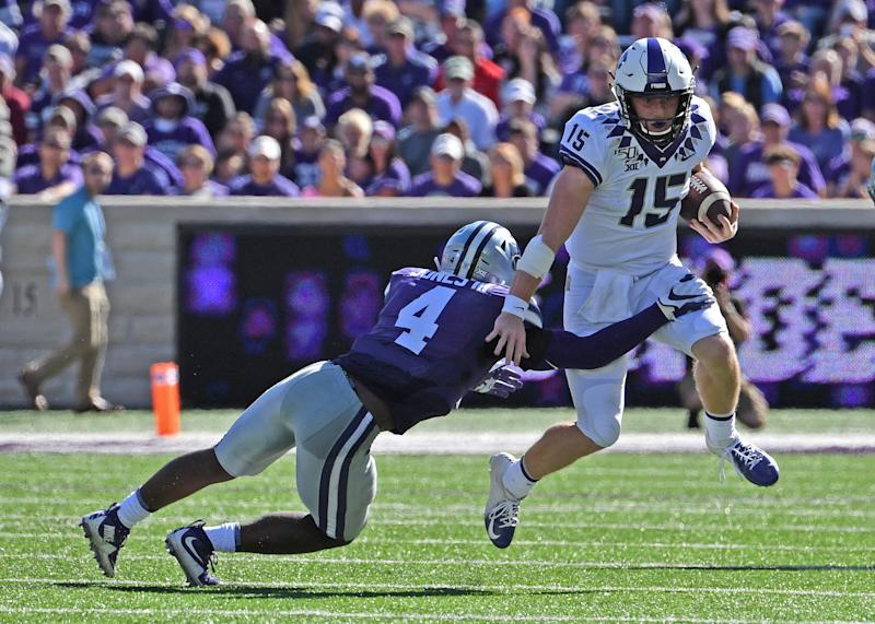 MANHATTAN, KS - OCTOBER 19: Quarterback Max Duggan #15 of the TCU Horned Frogs rushes up field against defensive back Wayne Jones #4 of the Kansas State Wildcats during the first half at Bill Snyder Family Football Stadium on October 19, 2019 in Manhattan, Kansas. (Photo by Peter G. Aiken/Getty Images)