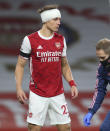 Arsenal's David Luiz has a bandage applied to his head following a head clash with Wolverhampton Wanderers' Raul Jimenez during the English Premier League soccer match between Arsenal and Wolverhampton Wanderers at Emirates Stadium, London, Sunday, Nov. 29, 2020. (Catherine Ivill/Pool via AP)