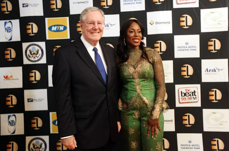 "In this photo taken Sunday June 30, 2013, Steve Forbes, Editor-in-Chief of Forbes Media, left, and Mo Abudu, chief executive officer of EbonyLife TV pose for photographers during the launch of Africa's first global black entertainment network in Lagos, Nigeria. Mo Abudu, who could be considered Africa's Oprah Winfrey, is launching an entertainment network that will be beamed into nearly every country on the continent with programs showcasing its burgeoning middle class. Mosunmola ""Mo"" Abudu wants EbonyLife TV to inspire Africans and the rest of the world, and change how viewers perceive the continent. (AP Photo/Sunday Alamba)"
