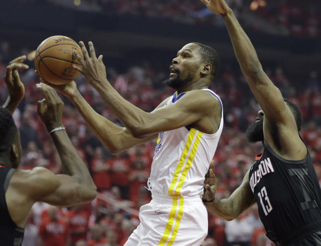 <p> Golden State Warriors forward Kevin Durant (35) drives to the basket past Houston Rockets guard James Harden (13) during the first half of Game 1 of the NBA basketball Western Conference Finals, Monday, May 14, 2018, in Houston. (AP Photo/David J. Phillip) </p>