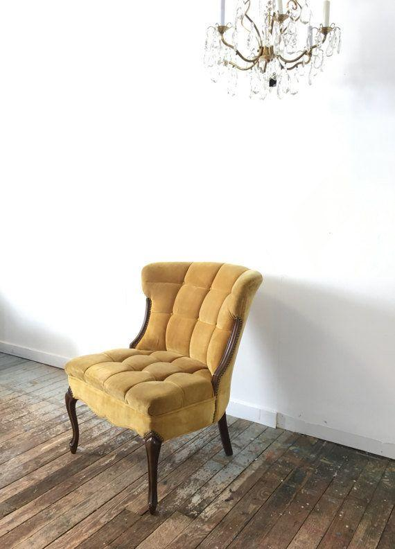 "This super chic tufted velvet chair would work great as a side chair or even as a desk chair. Get it on <a href=""https://www.etsy.com/listing/510244507/tufted-velvet-accent-chair-boho-chic?ga_order=most_relevant&ga_search_type=all&ga_view_type=gallery&ga_search_query=accent%20chair&ref=sr_gallery_8"" target=""_blank"">Etsy</a>."