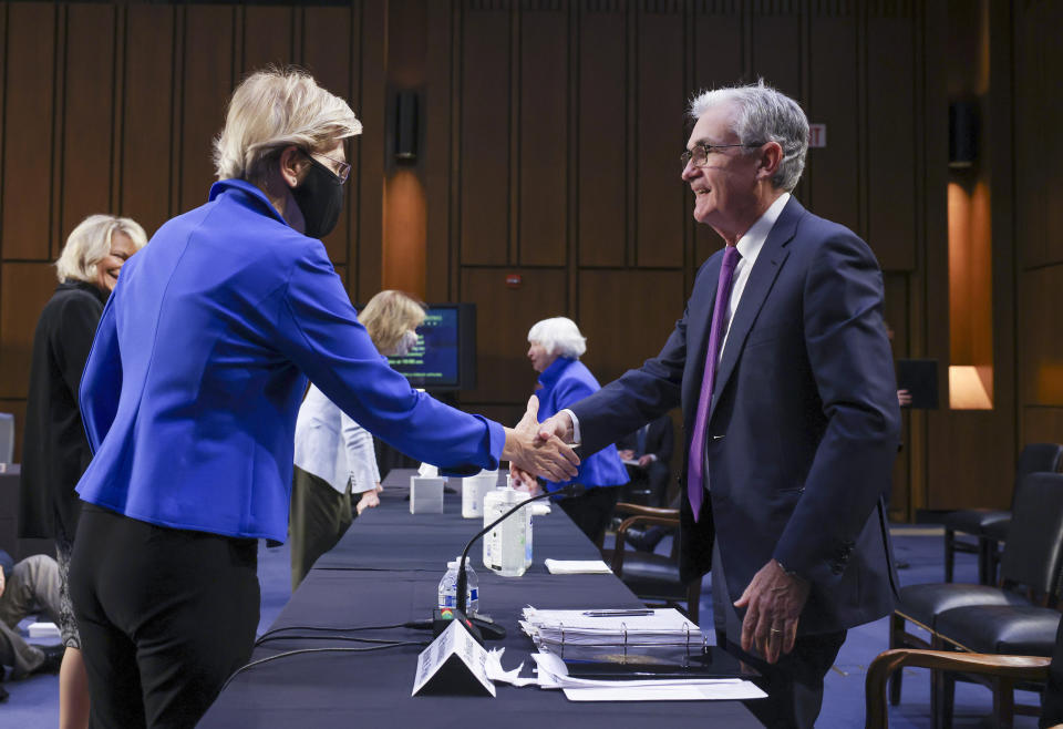 Sen. Elizabeth Warren, D-Mass., greets Federal Reserve Chairman Jerome Powell before a Senate Banking, Housing and Urban Affairs Committee hearing on the CARES Act on Capitol Hill, Tuesday, Sept. 28, 2021 in Washington. (Kevin Dietsch/Pool via AP)