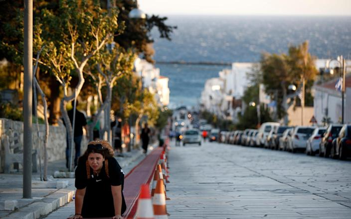 A pilgrim crawls from the port to the Holy Church of Panagia of Tinos, on the Aegean island of Tinos, Greece - AP