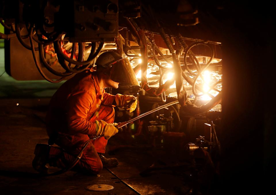 A technician works at the Badische Stahlwerke (BSW) steel plant, after a signed-project between French and German authorities, to convert heat rejected furnaces of the plant into a heating source for housings in Kehl, Germany and Strasbourg, France, in Kehl, Germany May 13, 2019. REUTERS/Vincent Kessler