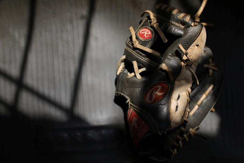 A baseball glove belonging to baseball little league player Eduar Pinto, 12, is seen at his house in Maracaibo, Venezuela. (Photo: Manaure Quintero/Reuters)
