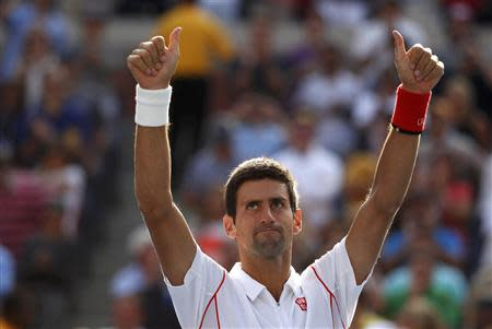 Novak Djokovic of Serbia celebrates after defeating Stanislas Wawrinka of Switzerland during their men's semi-final match at the U.S. Open tennis championships in New York September 7, 2013. REUTERS/Adam Hunger