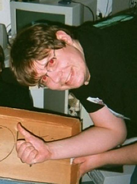 "This image provided by by Mike Cochran shows Neil E. Prescott in an undated photo. Cochran, a friend of Prescott, says the Maryland man accused of threatening to shoot up his workplace is a ""gentle giant"" who collected weapons and had expressed concerns about break-ins near his apartment complex. Cochran tells The Associated Press on Saturday, July 28, 2012, that he thinks Prescott did not intend for his comments to be taken seriously. Cochran says Prescott was known for having a sarcastic sense of humor. (AP Photo/Mike Cochran)"