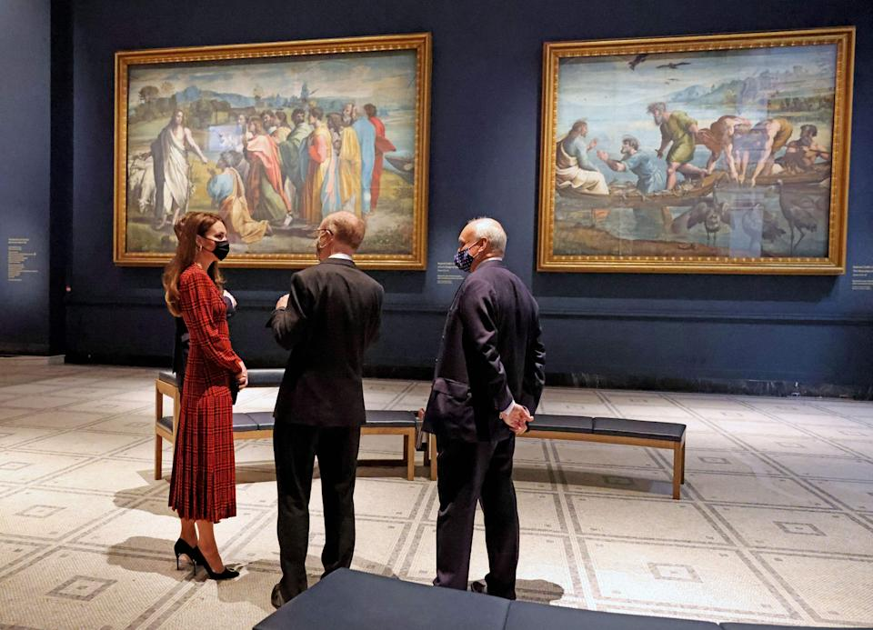 Britain's Catherine, Duchess of Cambridge (L), wearing a face covering, is shown artworks in the Raphael court during her visit to the Victoria and Albert (V&A) museum in London on May 19, 2021, as Covid-19 lockdown restrictions eased across the country this week. (Photo by Jonathan Buckmaster / POOL / AFP) (Photo by JONATHAN BUCKMASTER/POOL/AFP via Getty Images)