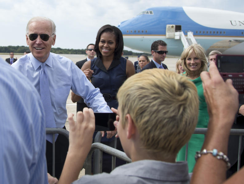 FILE - In this Sept. 7, 2012, file photo, from left, Vice President Joe Biden, first lady Michelle Obama, and Jill Biden greet people on the tarmac as they arrive at Portsmouth International Airport at Pease, in Newington, N.H. Seeking to unite Democrats, Joe Biden has raced to line up supporters ranging from progressive icon Bernie Sanders to former President Barack Obama, whose administration sometimes irked liberals. But the person with the most influence may be Michelle Obama. (AP Photo/Carolyn Kaster, File)