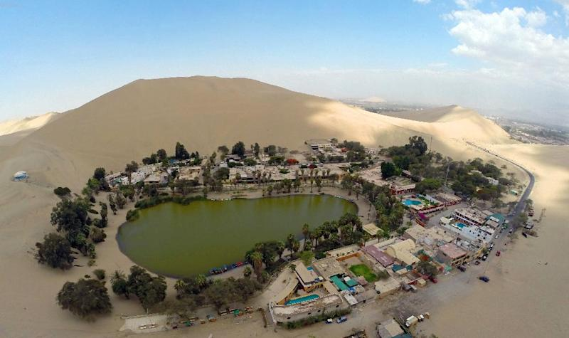 Aerial view of the Huacachina Oasis in Ica, some 300 km south of Lima, Peru, on December 11, 2014 (AFP Photo/Martin Bernetti)