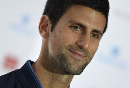 Djokovic loses cool after opening win in London