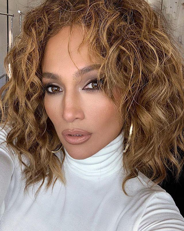 "<p>The '90s resurgence isn't going anywhere. JLo's nude lip and liner and brown smoky eye are the perfect nod to the decade we all love.</p><p>KKW Beauty Nude Lip Liner, $12, <a href=""https://www.ulta.com/nude-lip-liner?productId=pimprod2011542"" rel=""nofollow noopener"" target=""_blank"" data-ylk=""slk:ulta.com"" class=""link rapid-noclick-resp"">ulta.com</a> <br><br> <a class=""link rapid-noclick-resp"" href=""https://go.redirectingat.com?id=74968X1596630&url=https%3A%2F%2Fwww.ulta.com%2Fnude-lip-liner%3FproductId%3Dpimprod2011542&sref=https%3A%2F%2Fwww.harpersbazaar.com%2Fbeauty%2Fmakeup%2Fg34304753%2Fwinter-makeup-trends-2020-2021%2F"" rel=""nofollow noopener"" target=""_blank"" data-ylk=""slk:SHOP"">SHOP</a></p><p><a href=""https://www.instagram.com/p/CF4g6V6JedF/"" rel=""nofollow noopener"" target=""_blank"" data-ylk=""slk:See the original post on Instagram"" class=""link rapid-noclick-resp"">See the original post on Instagram</a></p>"