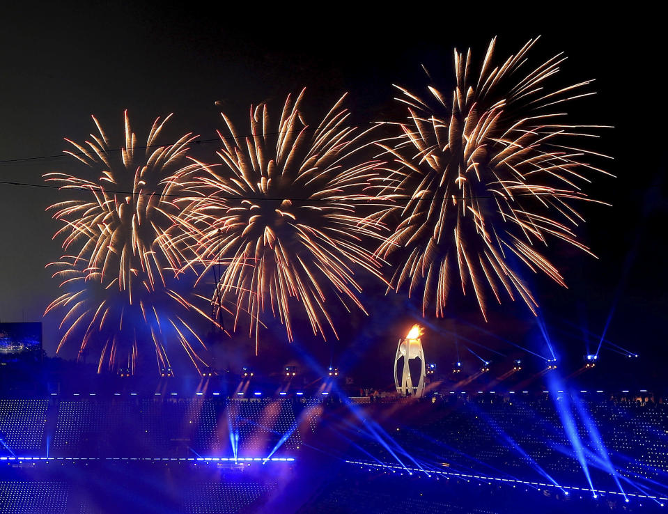 <p>Fireworks go off after the Olympic flame was lit during the opening ceremony of the 2018 Winter Olympics in Pyeongchang, South Korea, Friday, Feb. 9, 2018. (Sean Haffey/Pool Photo via AP) </p>