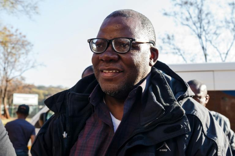 Opposition figure Tendai Biti arrived in handcuffs at Harare Magistrates Court after being deported from Zambia