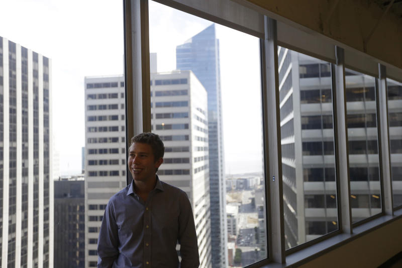 In this photo taken Sept. 21, 2012, Kevin Mahaffey, chief technology officer and co-founder, poses for a portrait at the Lookout Mobile Security headquarters in San Francisco. A woman riding a city bus is punched in the face, then her cell phone is snatched. A man walking near Golden Gate Park is asked for the time, then a gunman demands his phone and wallet. Police say nearly one out of every three robberies in San Francisco this year has involved a cell phone. (AP Photo/Marcio Jose Sanchez)