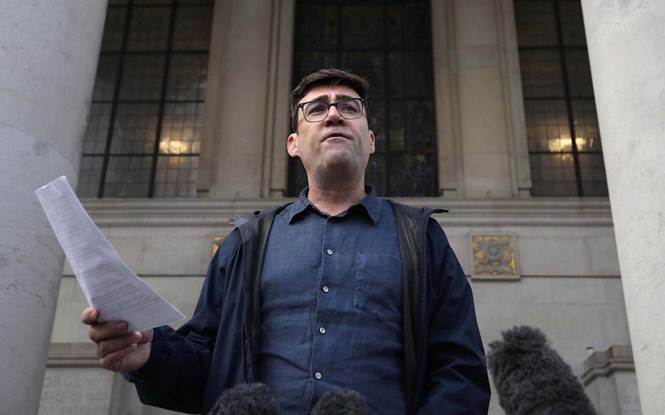 Greater Manchester mayor Andy Burnham speaking to the media outside the Central Library in Manchester, he has threatened legal action if Tier 3 restrictions are imposed without agreement - Martin Rickett/PA Wire