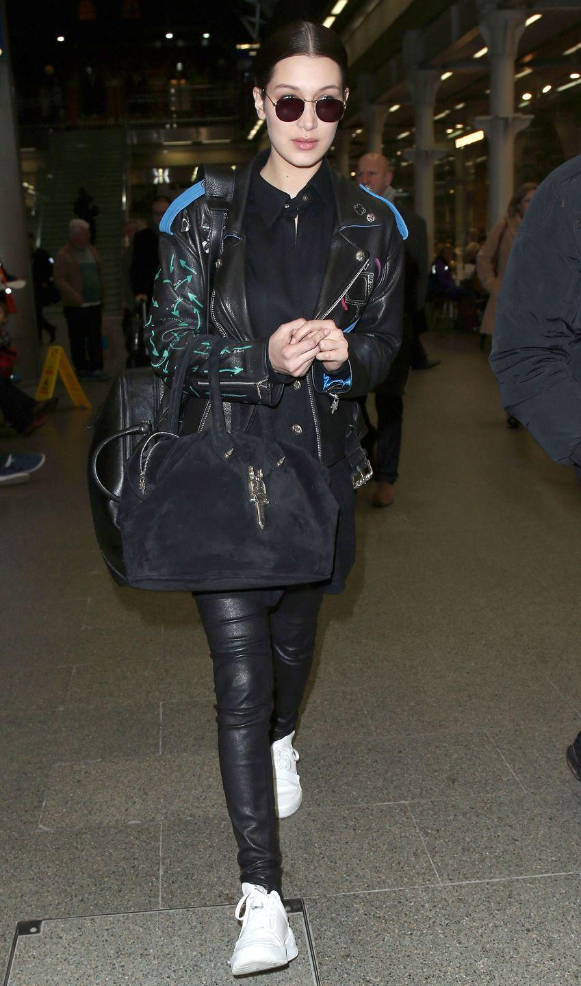 <p>In leather pants, moto jacket, black shirt and sneakers arriving at Kings Cross St Pancras Eurostar on in London, England. </p>