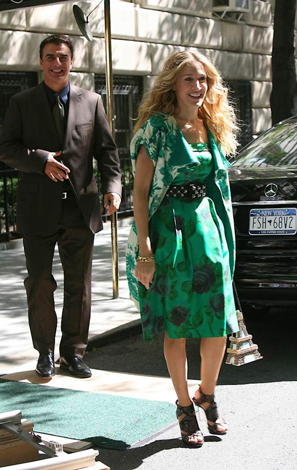 "Judging from her Eiffel Tower handbag, Carrie Bradshaw (Sarah Jessica Parker) hasn't lost her funky sense of style. Mr. Big (Chris Noth) looks on with amusement. Jennifer Mitchell/<a href=""http://www.splashnewsonline.com"" target=""new"">Splash News</a> - September 18, 2007"