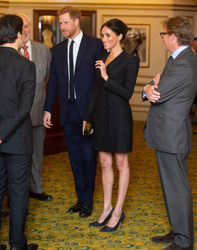 Harry and Meghan wore black-tie for the occasion. [Photo: Rex]