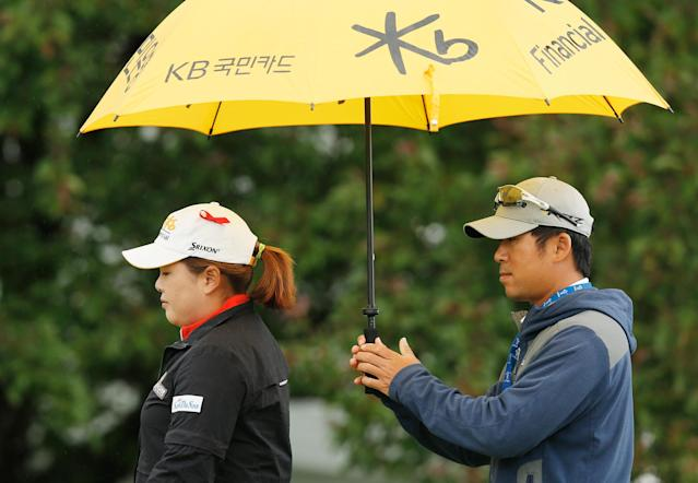 PITTSFORD, NY - JUNE 08: Inbee Park of South Korea (L) works on the practice ground with her fiance and coach, Gihyeob Nam during the weather-delayed second round of the Wegmans LPGA Championship at Locust Hill Country Club on June 8, 2013 in Pittsford, New York. (Photo by Scott Halleran/Getty Images)