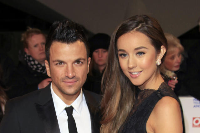 Peter Andre, left, and Emily Macdonagh seen at the National Television Awards at the o2 Arena on Wednesday, Jan. 23, 2013, in London. Joel Ryan/Invision/AP)